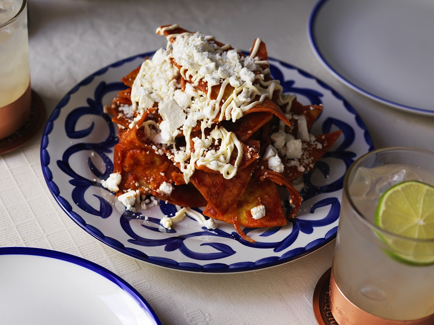 Chilaquiles Red salsa drowned corn chips cheese web