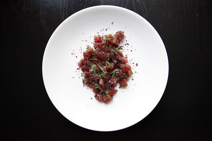 Tuna crudo with Davidson plum and black sesame seeds